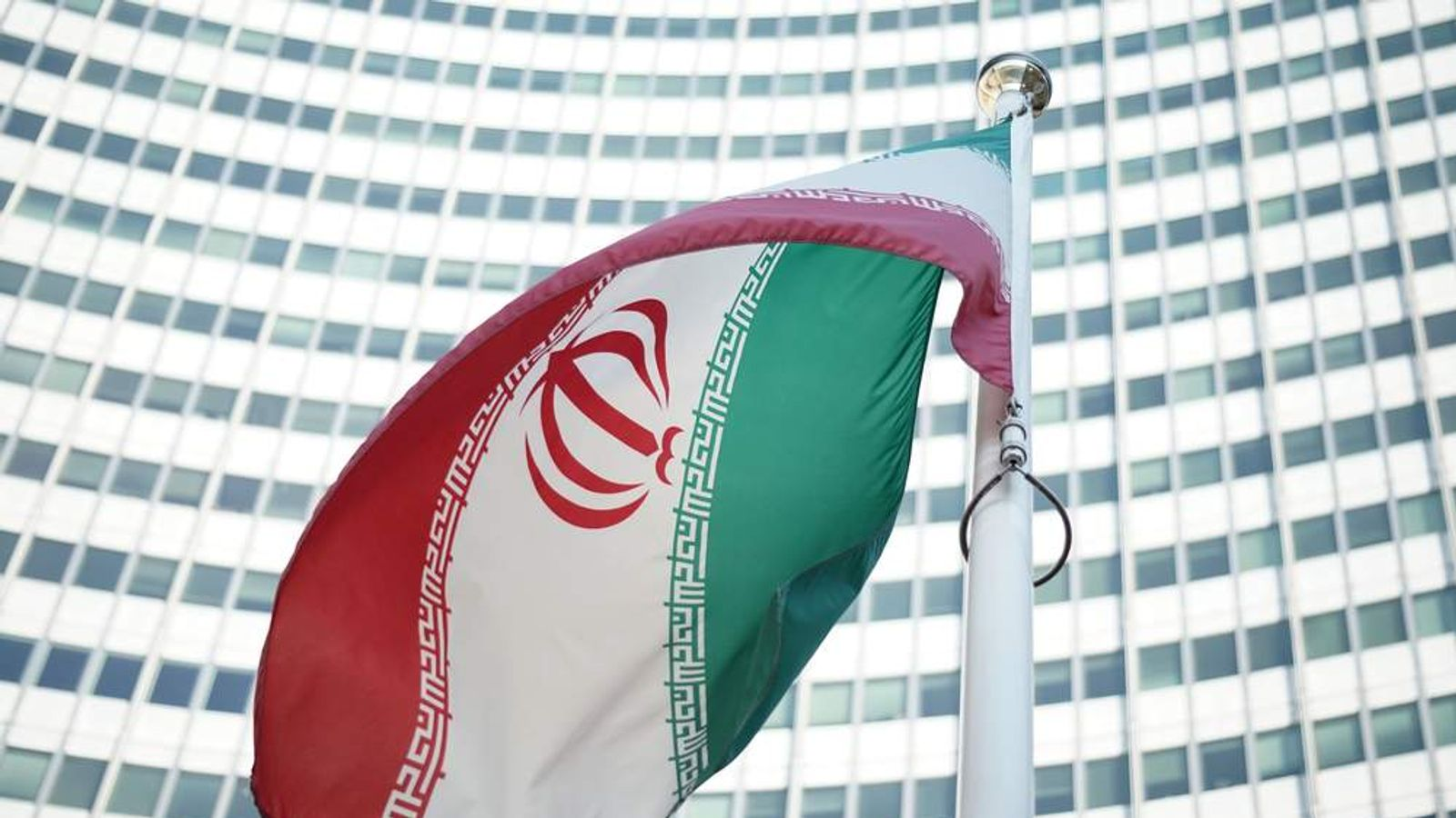 An Iranian flag waves in a wind outside the Vienna International Centre