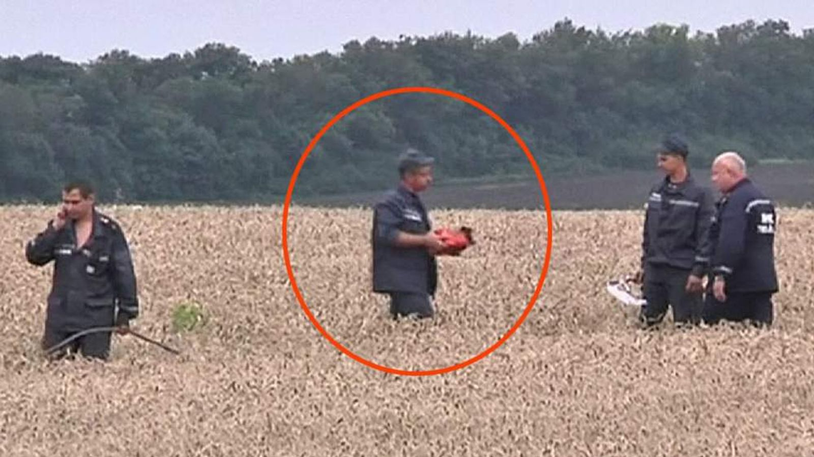 A flight recorder being taken away from a plane crash site