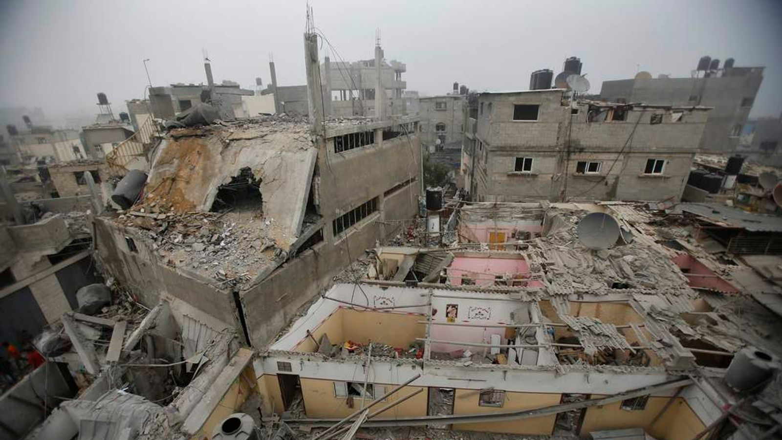 A mosque and a house which witnesses said were damaged by an Israeli air strike that killed two children, is seen in the northern Gaza Strip