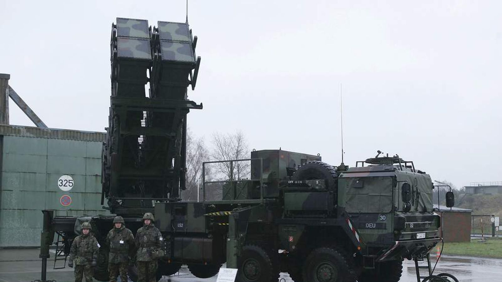 Members of the German Lutfwaffe stand next to a Patriot anti-missile launcher