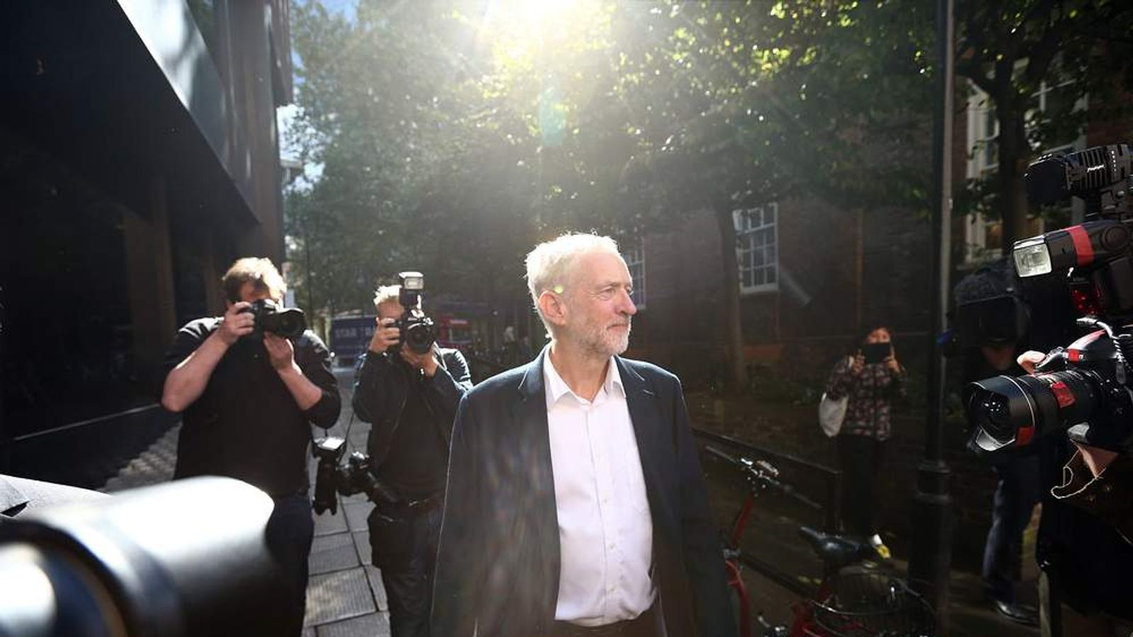 Newly elected Labour Party leader Jeremy Corbyn leaves the Labour Party headquarter