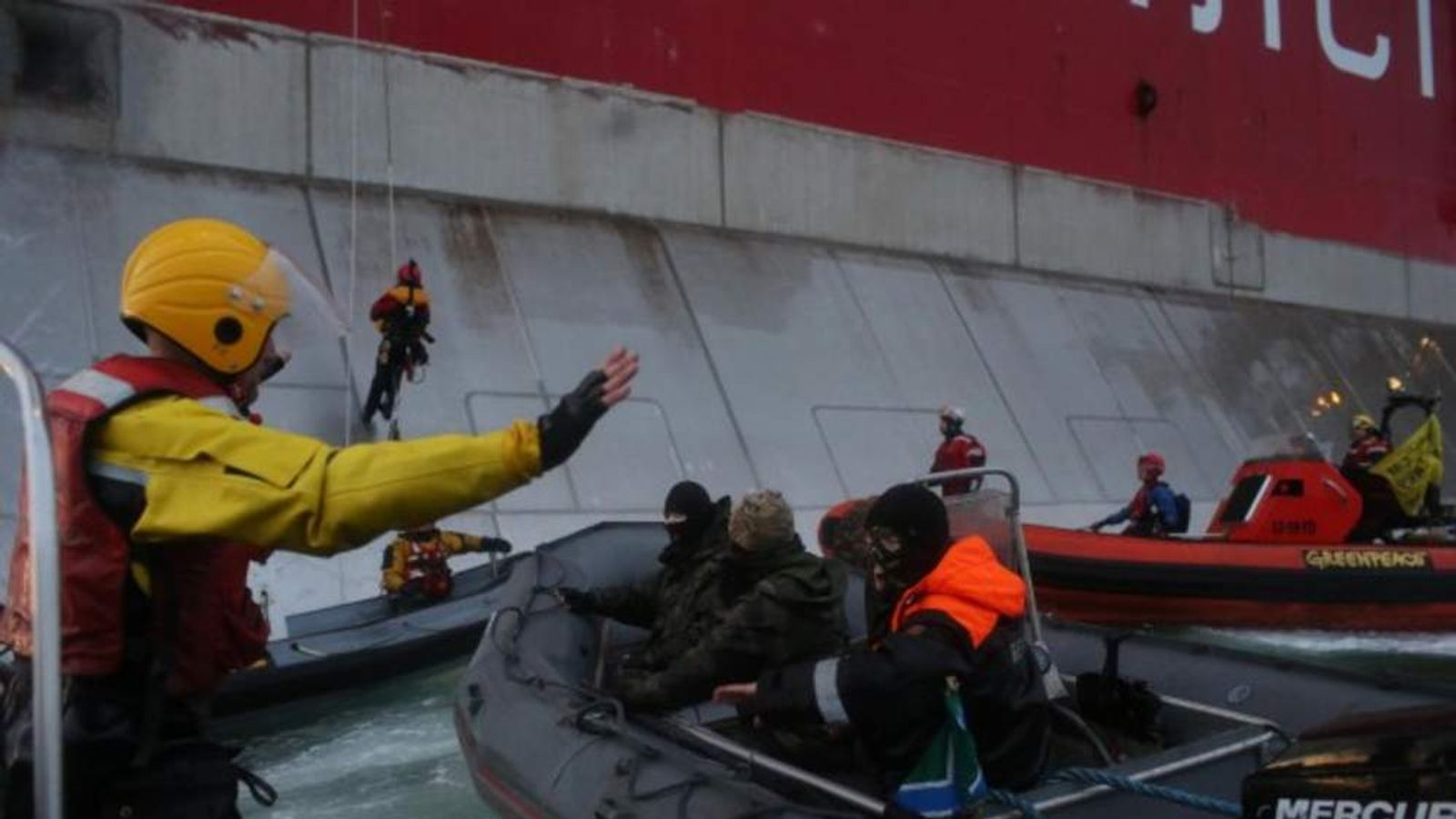 Armed Russian coastguard arrest two Greenpeace activists