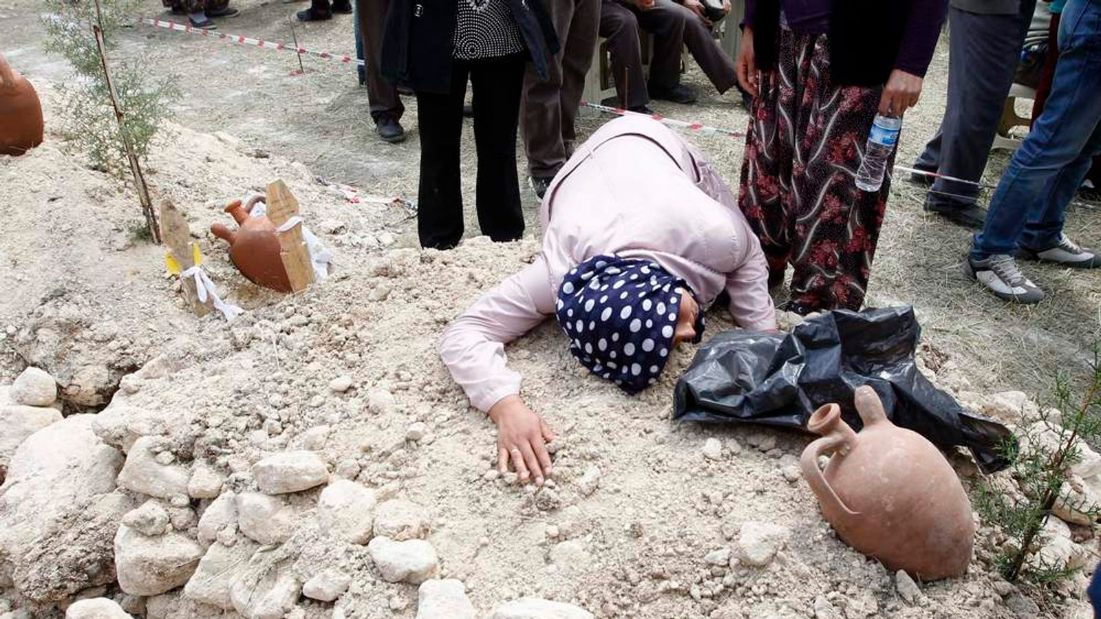 A woman mourns during the funeral of a miner killed in Soma