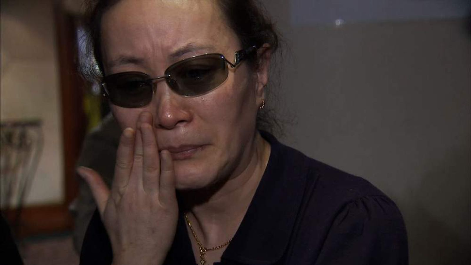 A relative grieiving for her missing loved one on the Malaysian plane