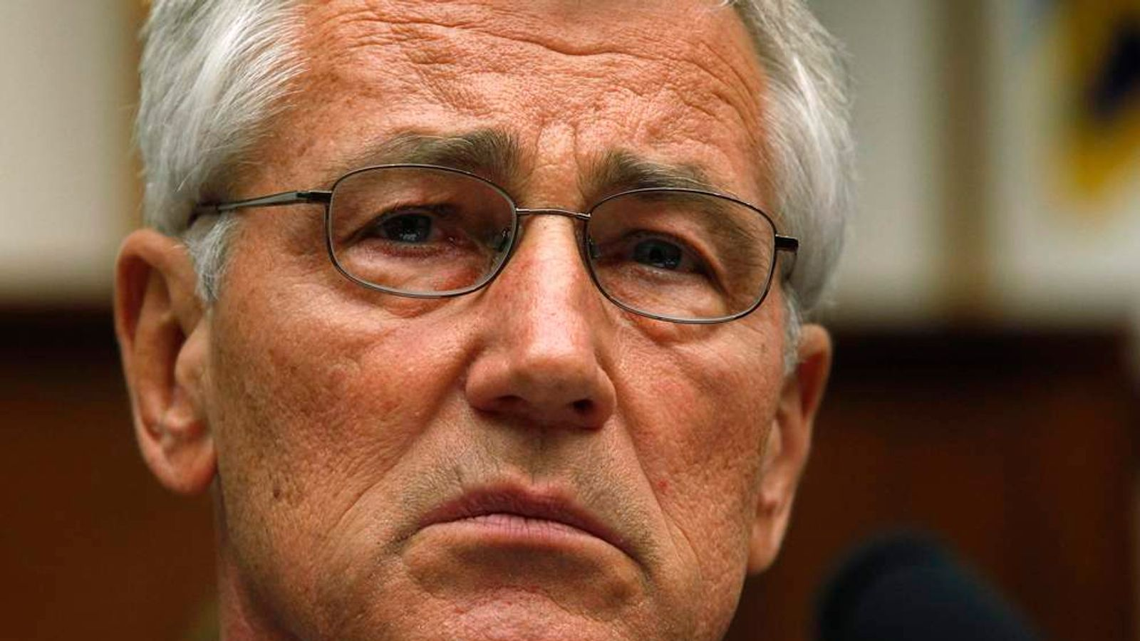 U.S. Defense Secretary Hagel listens to opening statements before testifying about the Bergdahl prisoner exchange on Capitol Hill in Washington