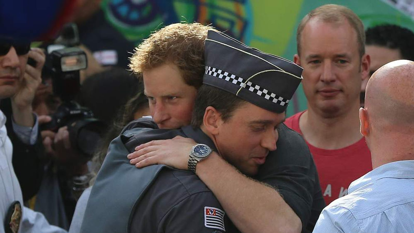 Prince Harry thanks a local policeman for his work