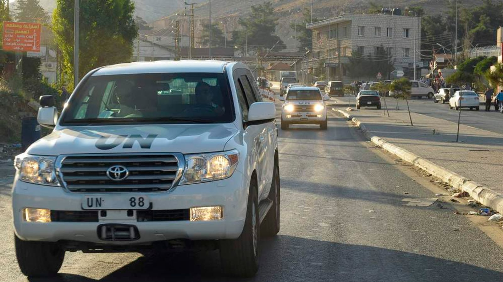 UN inspectors leave the Masnaa border crossing between Lebanon and Syria