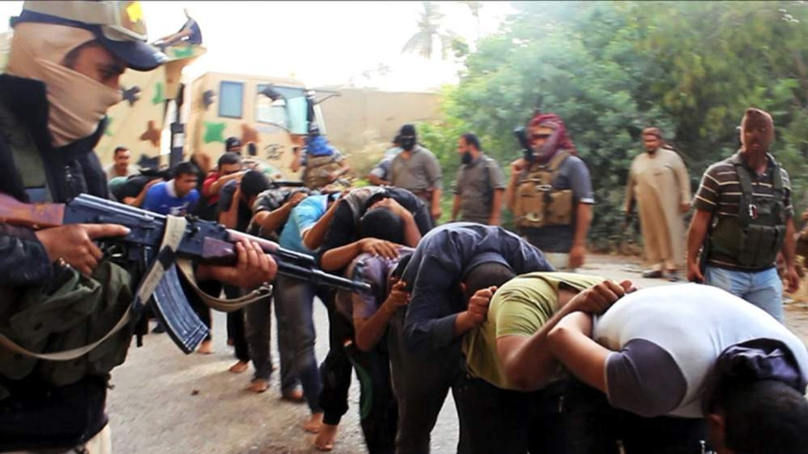 ISIS photos showing Iraqi men being led to their death.