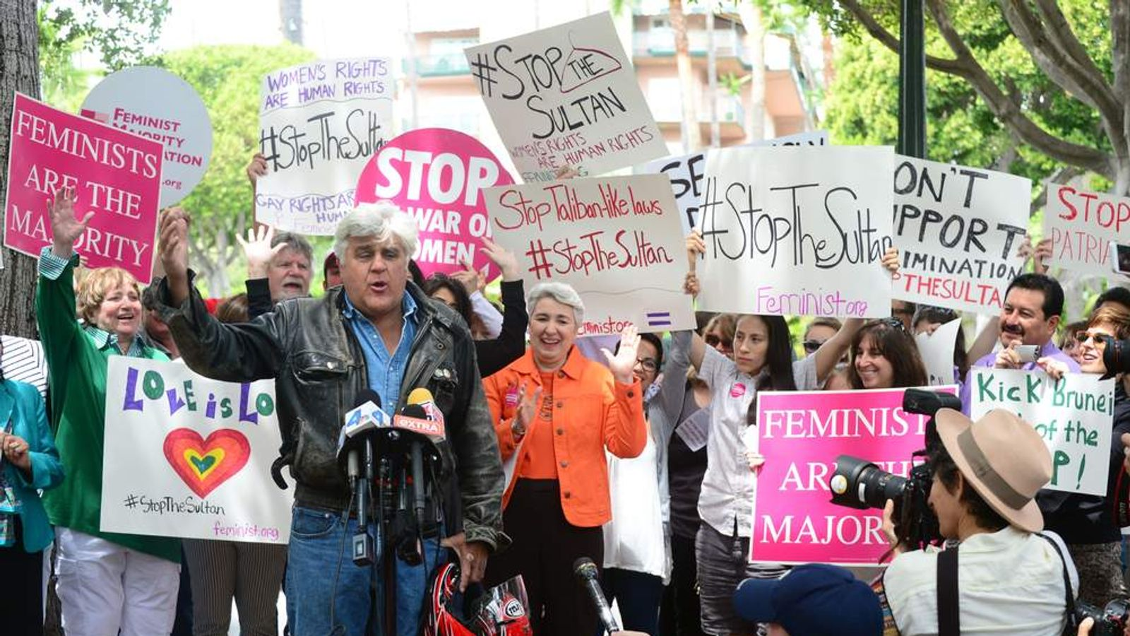 Jay Leno speaks at a gathering of Women's Rights and LGBT groups protesting outside the Beverly Hills Hotel