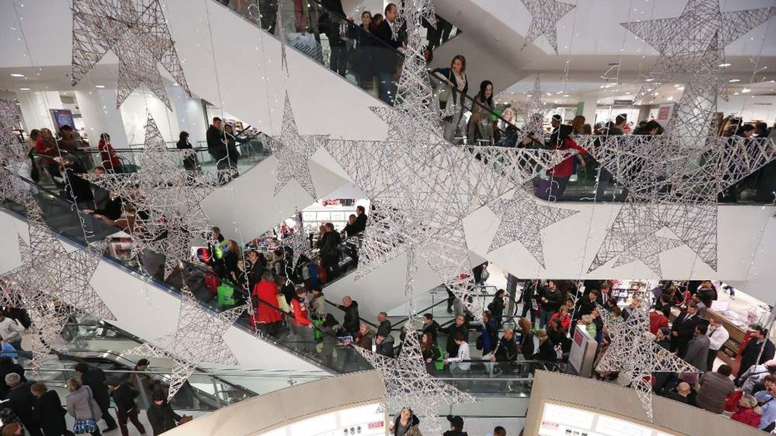 Christmas shoppers in the atrium of John Lewis Oxford Street
