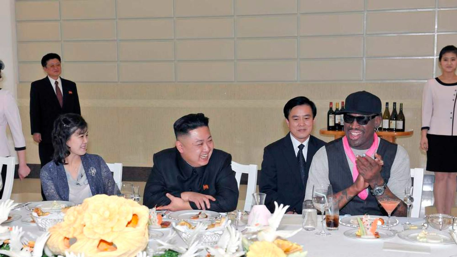 North Korean leader Kim Jong-Un, his wife Ri Sol-Ju and former NBA basketball player Dennis Rodman talk in Pyongyang