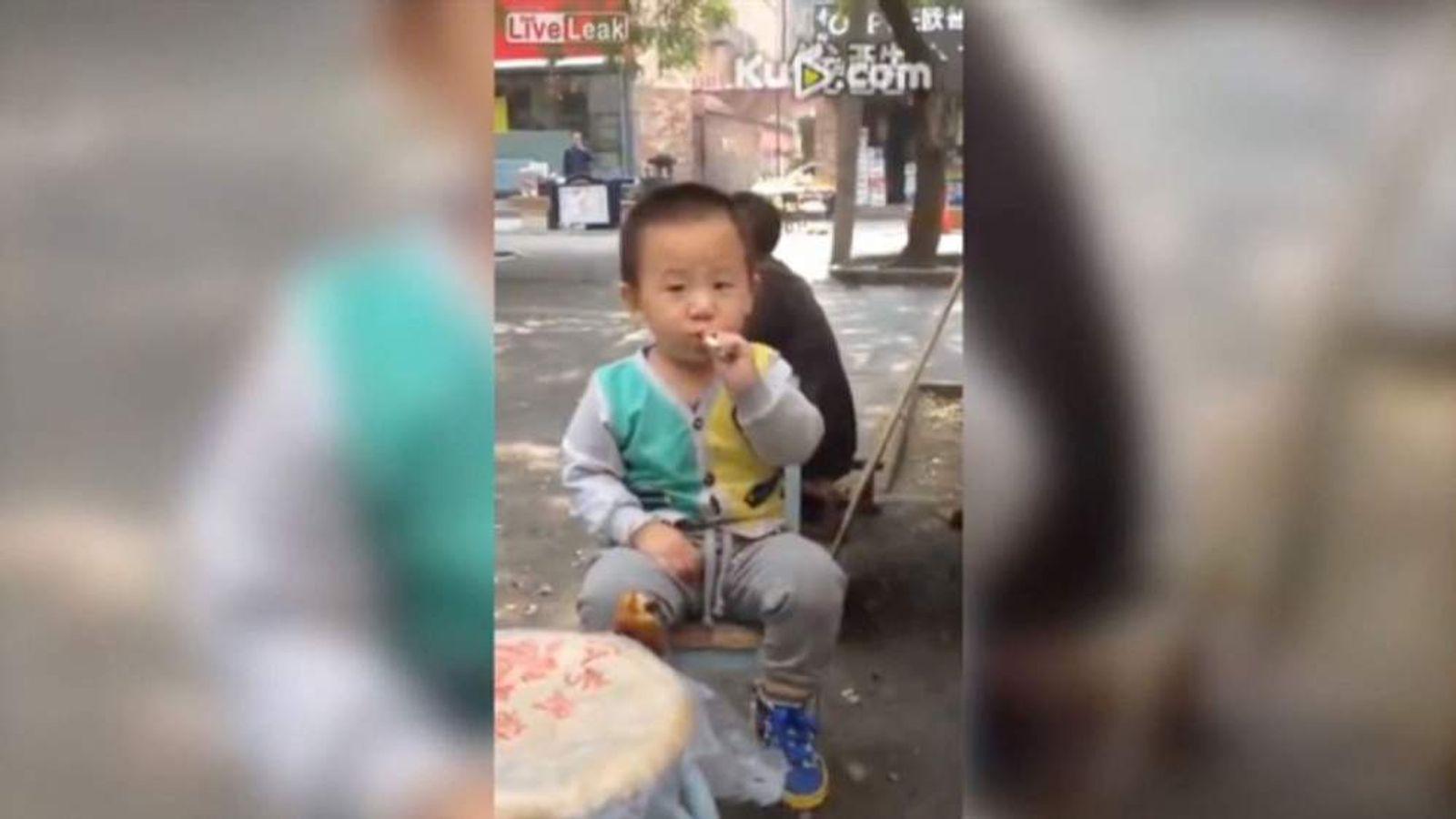 Smoking toddler (LiveLeak)