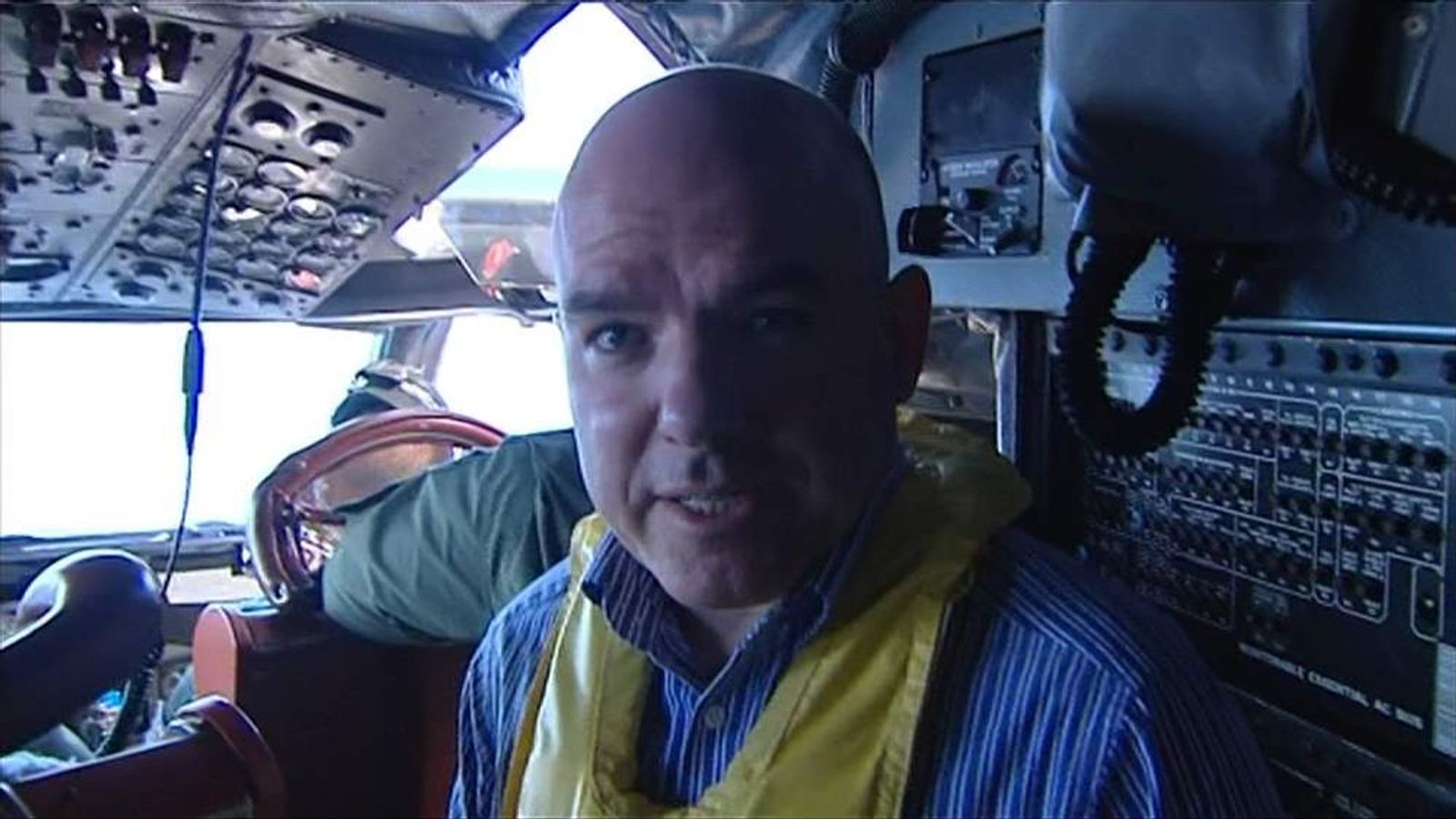 Sky's James Matthews aboard a RAAF P-3 Orion search aircraft