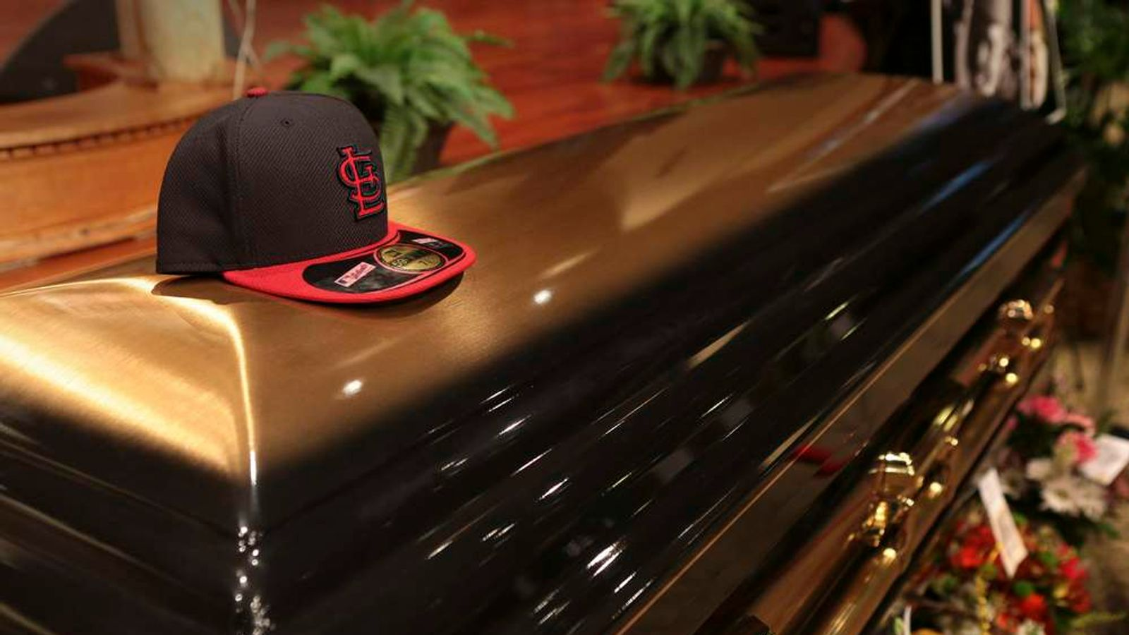 A baseball cap sits on top of the casket of Michael Brown inside Friendly Temple Missionary Baptist Church before the start of funeral services in St. Louis