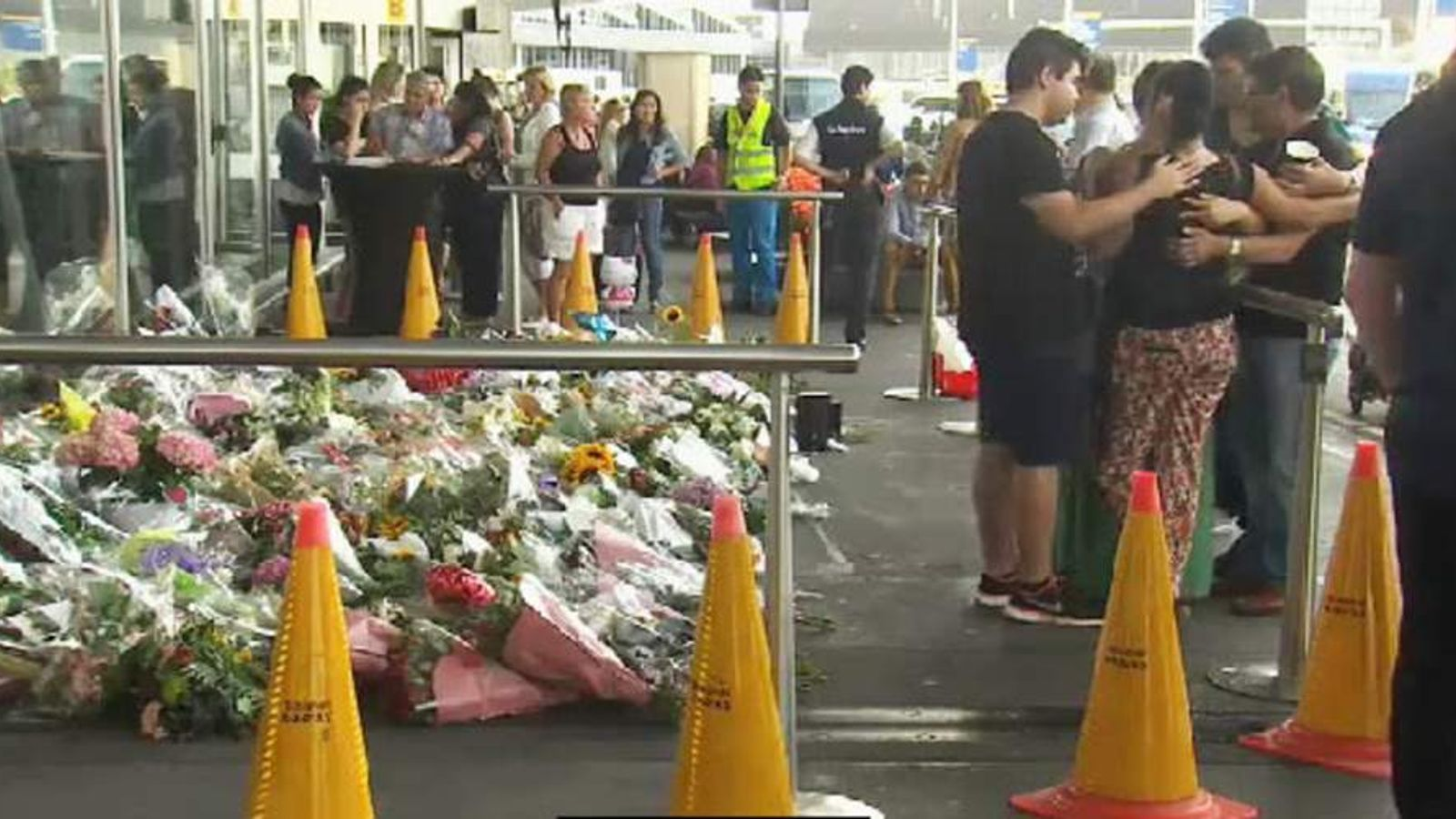 Mourners at Schipol Airport in the Netherlands