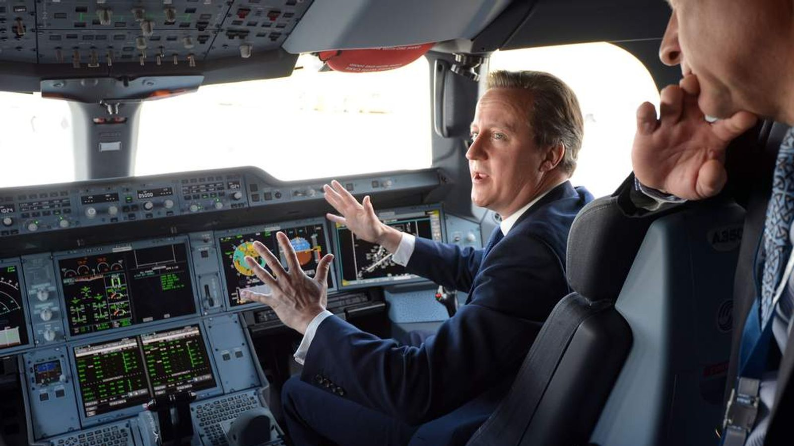 Prime Minister David Cameron sits in the co-pilots seat in the cockpit as he is shown around an Airbus A350