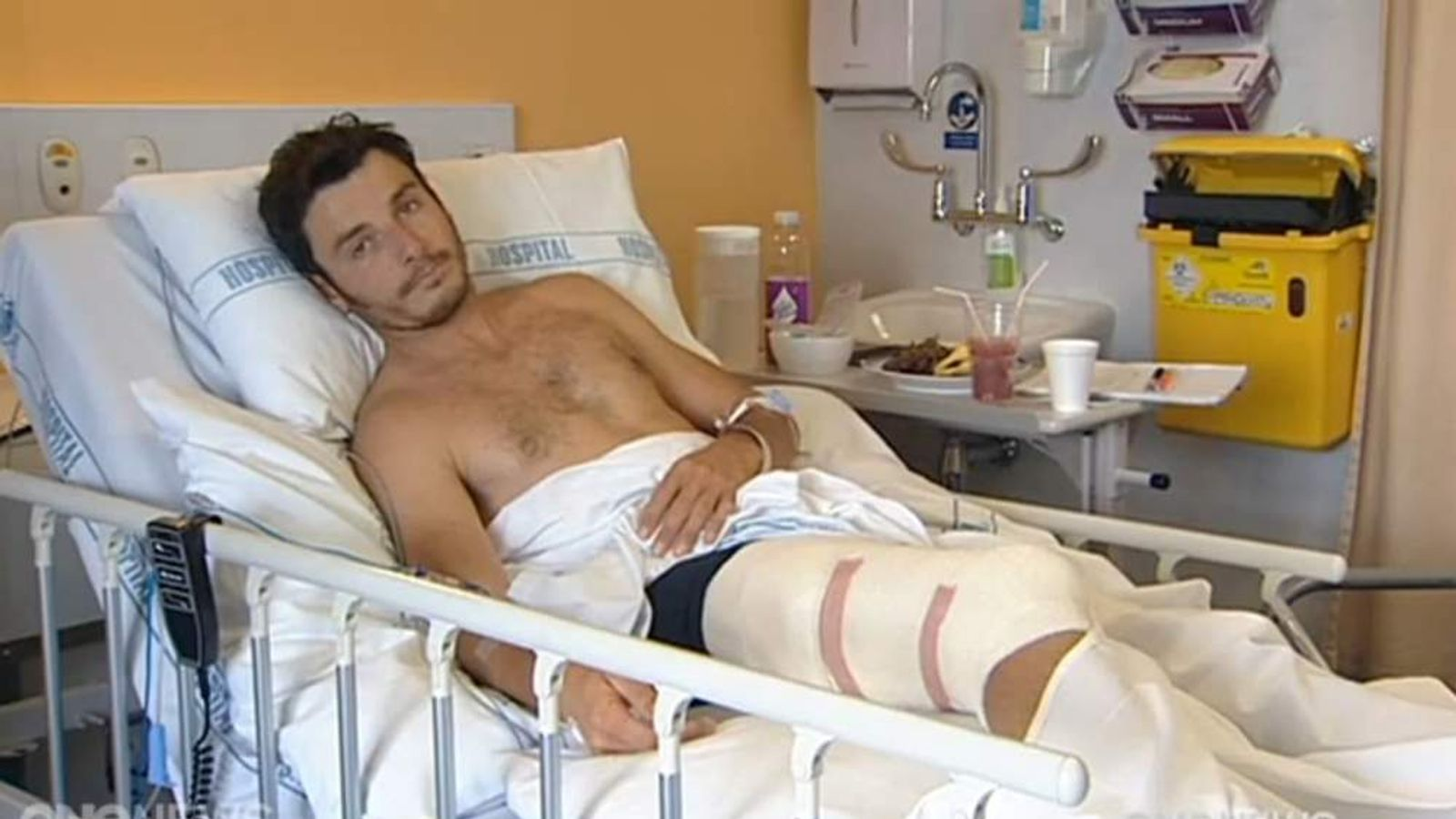 Darren Mills lying in hospital in New Zealand. Pic: ONE News.