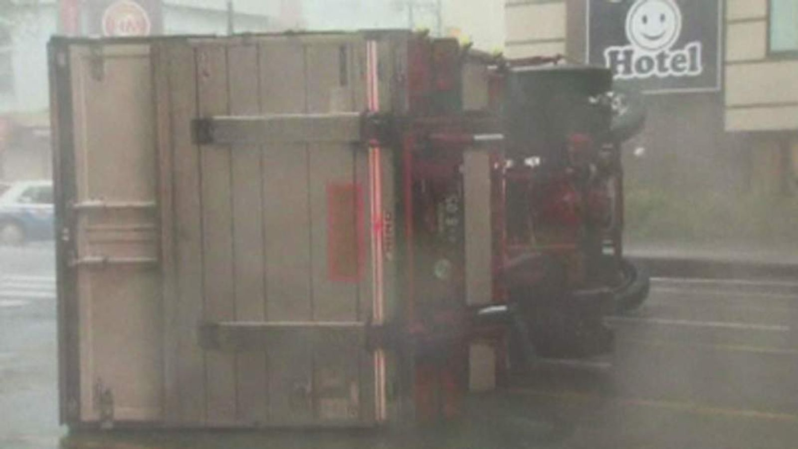 An overturned lorry after a typhoon hits southern Japan.