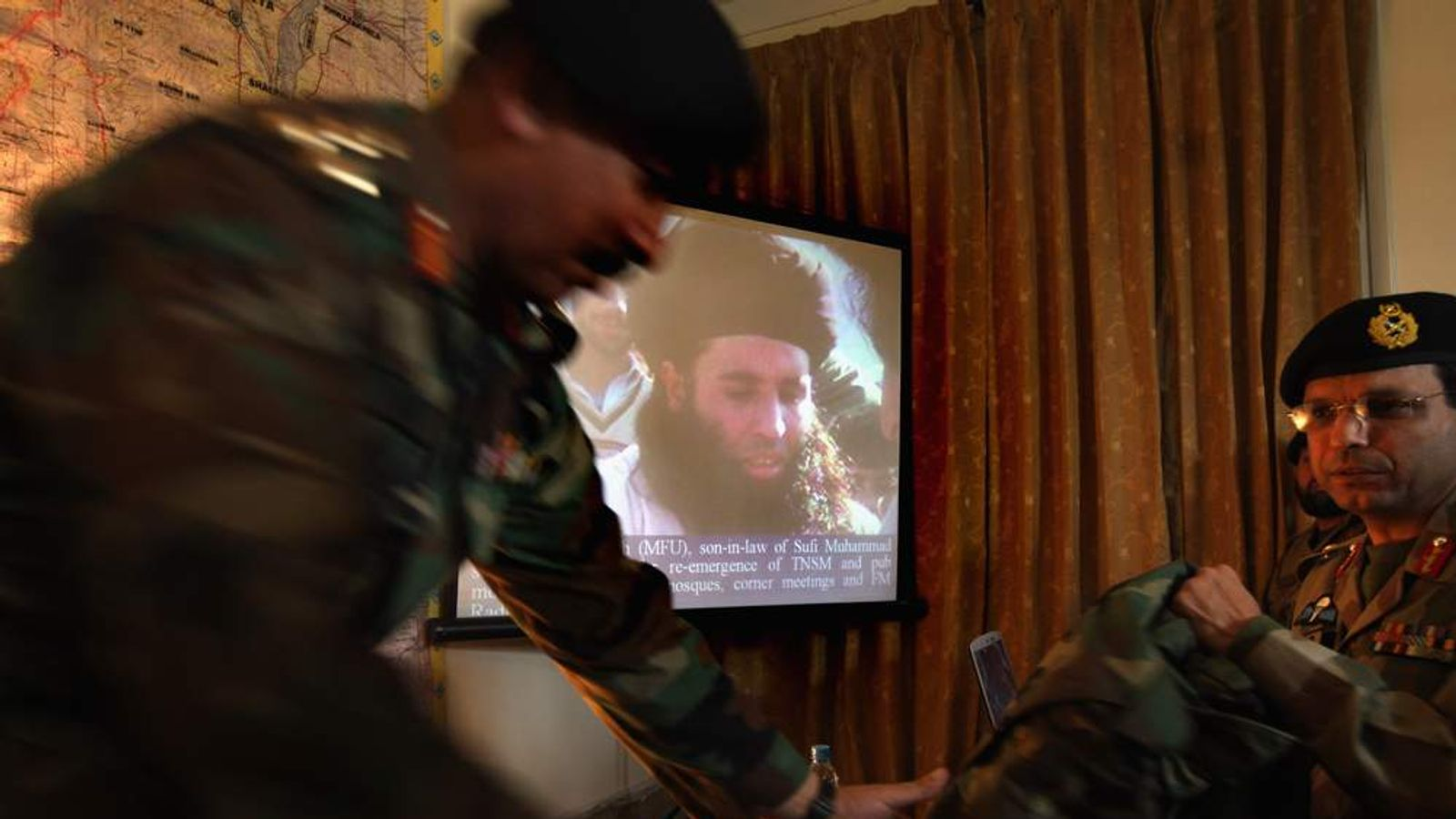 Pakistani Army officers show a photo of radical Islamic Cleric and militant leader Muaulana Fazlullah