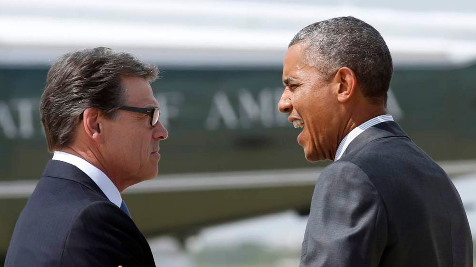 U.S. President Obama is greeted by Texas Governor Perry upon Obama's arrival in Dallas