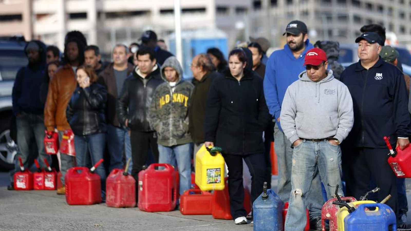 People line up at a gas station after Hurricane Sandy