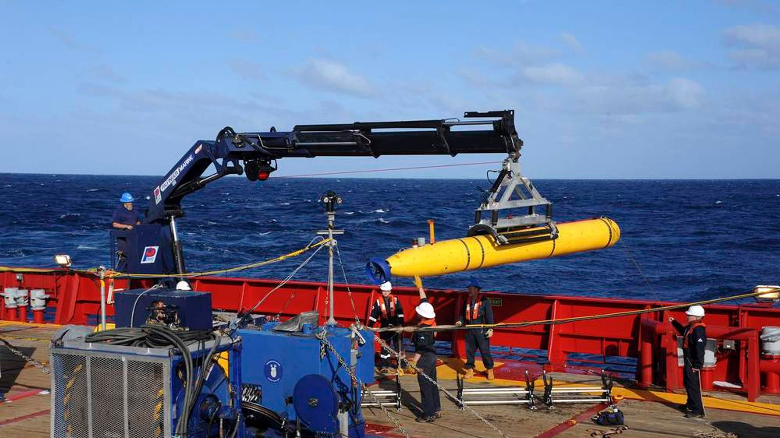 The Bluefin 21, the Artemis AUV, is hoisted back on board the Australian Defence Vessel Ocean Shield after a buoyancy test in the southern Indian Ocean during the continuing search for missing Malaysian Airlines flight MH370