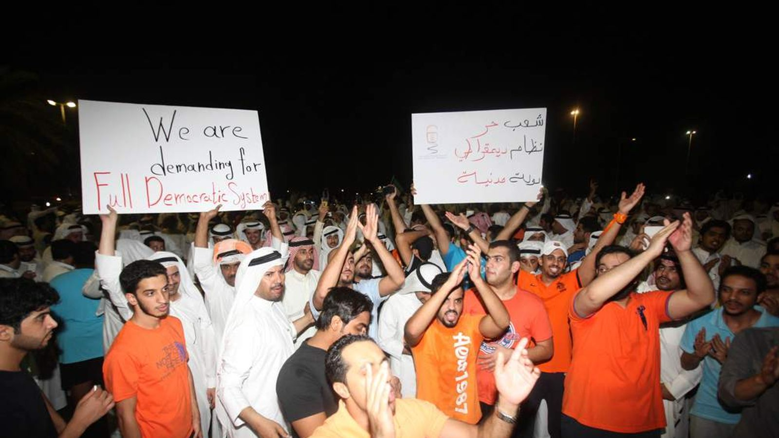 Kuwaiti opposition supporters protest in Kuwait City, on October 21, 2012,