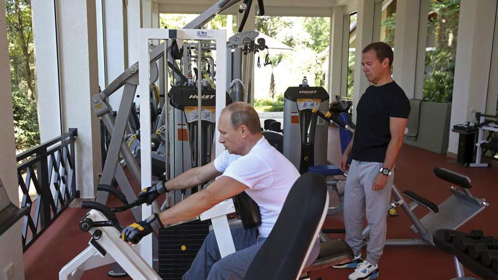 Russian President Putin and Prime Minister Medvedev exercise in a gym at the Bocharov Ruchei state residence in Sochi