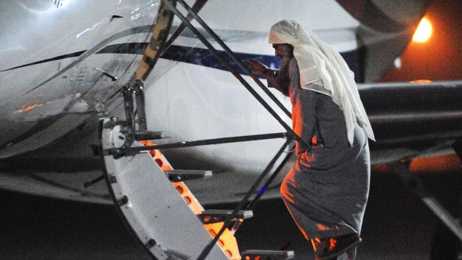 Abu Qatada boards plane at RAF Northolt