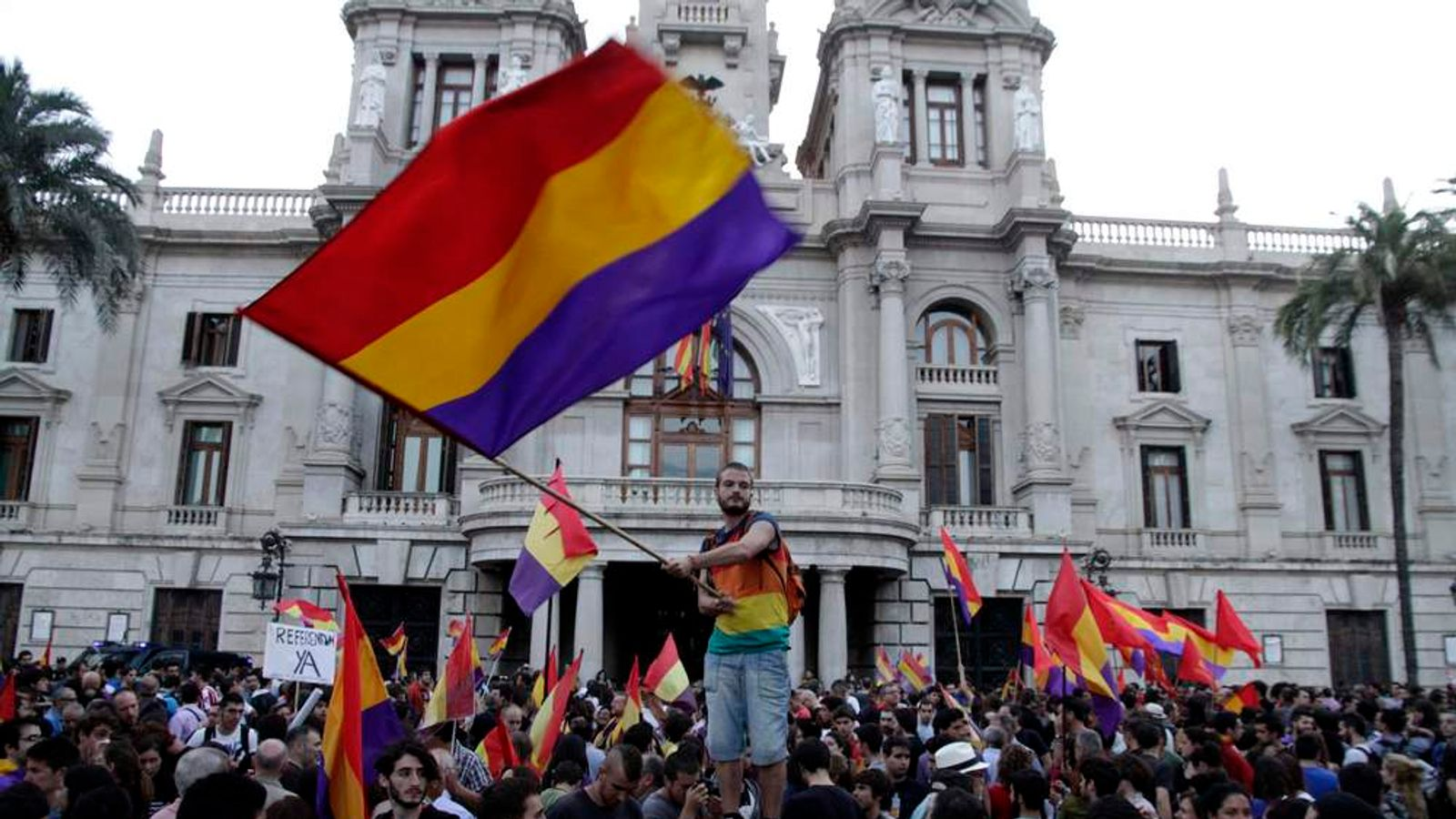 Protesters wave Spanish Second Republic flags during an anti-royalist demonstration at the town hall square in Valencia