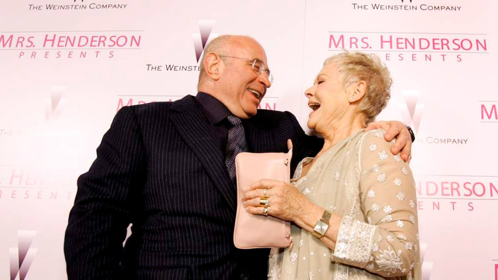 """Cast member Dench laughs with co-star Hoskins at premiere of """"Mrs Henderson Presents"""" in Beverly Hills"""