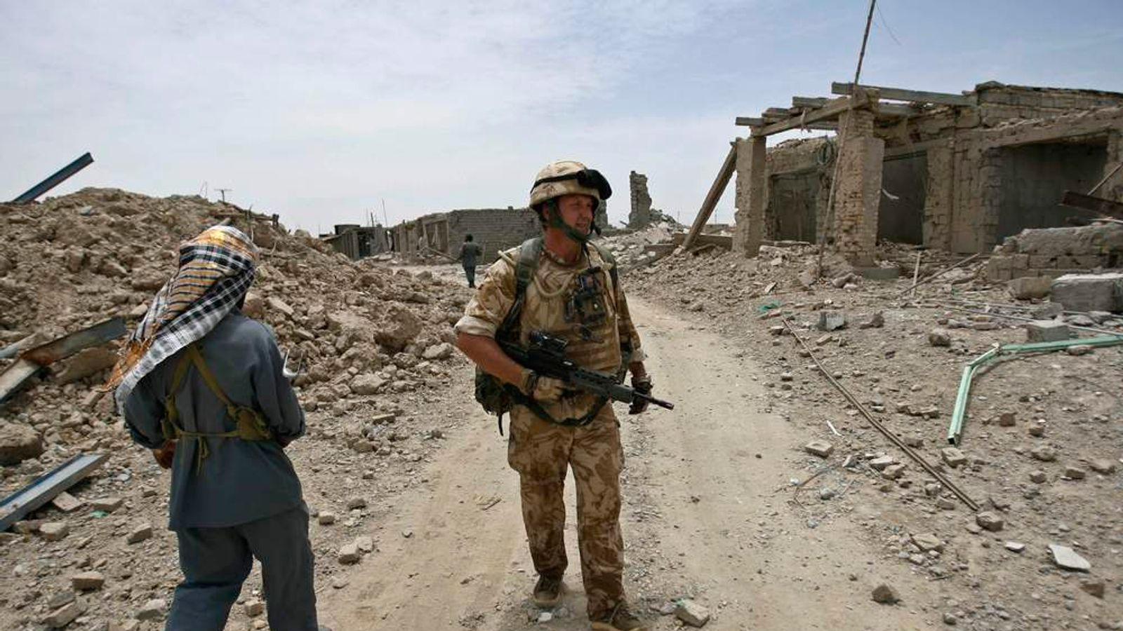 A British soldier and an Afghan policeman patrol in Afghanistan's Sangin valley