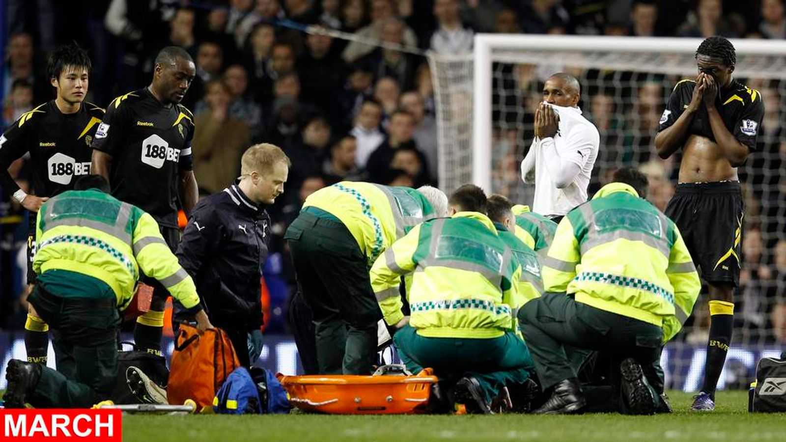 Bolton Wanderers players look on as medical staff attend to Fabrice Muamba after he collapsed on the pitch during their FA Cup quarter-final soccer match against Tottenham Hotspur at White Hart Lane in London