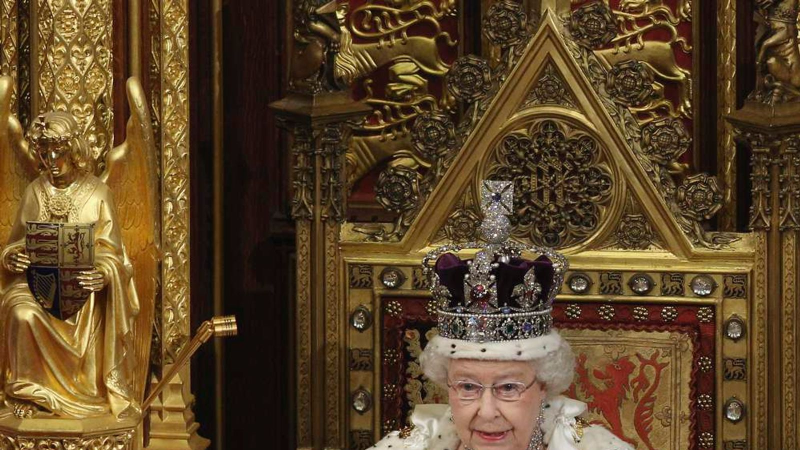 Britain's Queen Elizabeth reads the Queen's Speech to lawmakers in the House of Lords during the State Opening of Parliament in central London