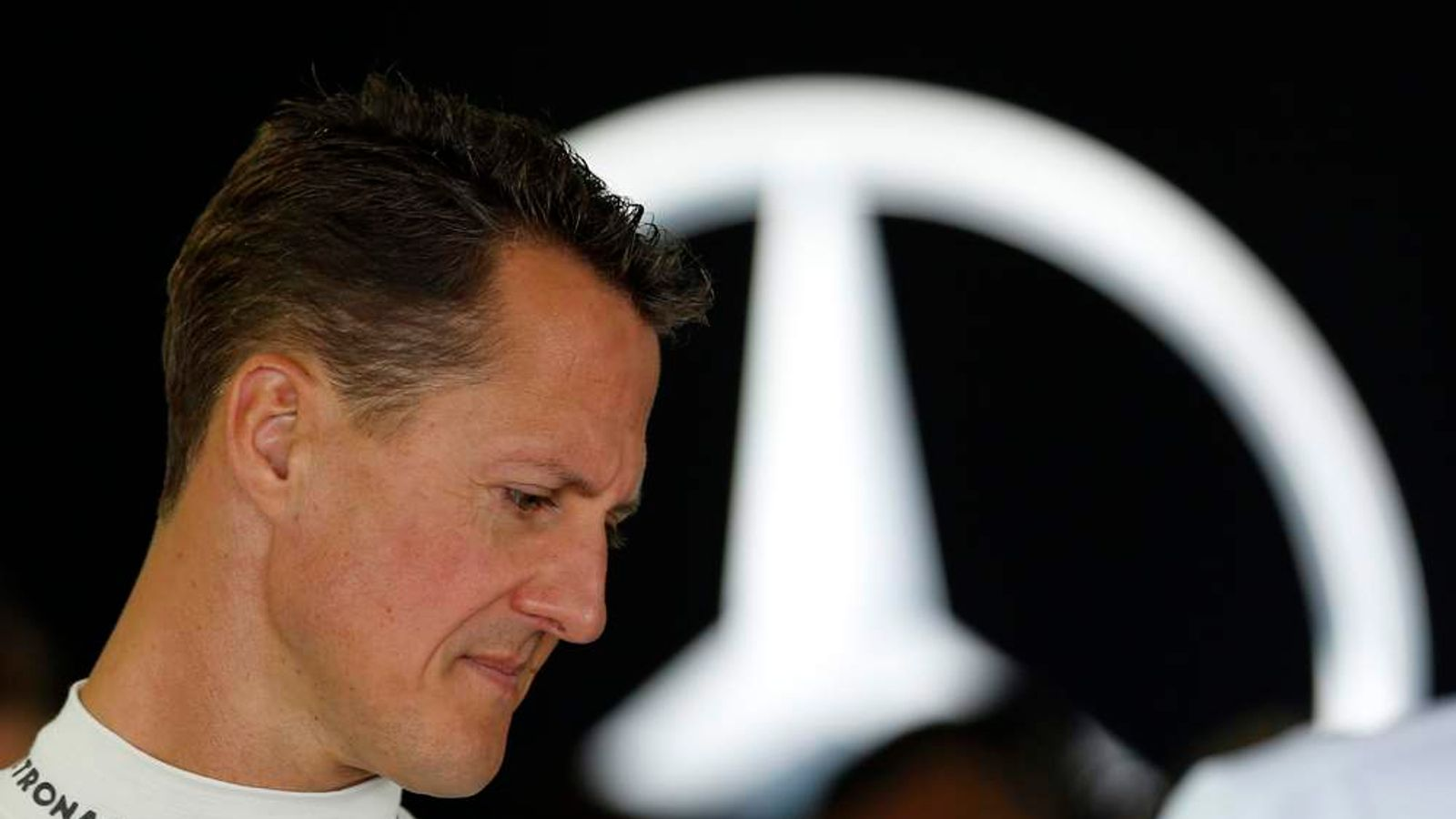 Mercedes Formula One driver Schumacher stands inside his team garage during the first practice session of the Japanese F1 Grand Prix at the Suzuka circuit
