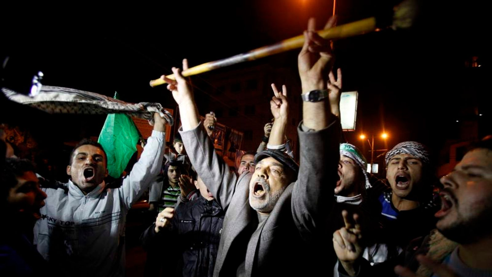 Palestinians celebrate what they say is a victory over Israel after an eight-day conflict in Gaza City November 21, 2012.