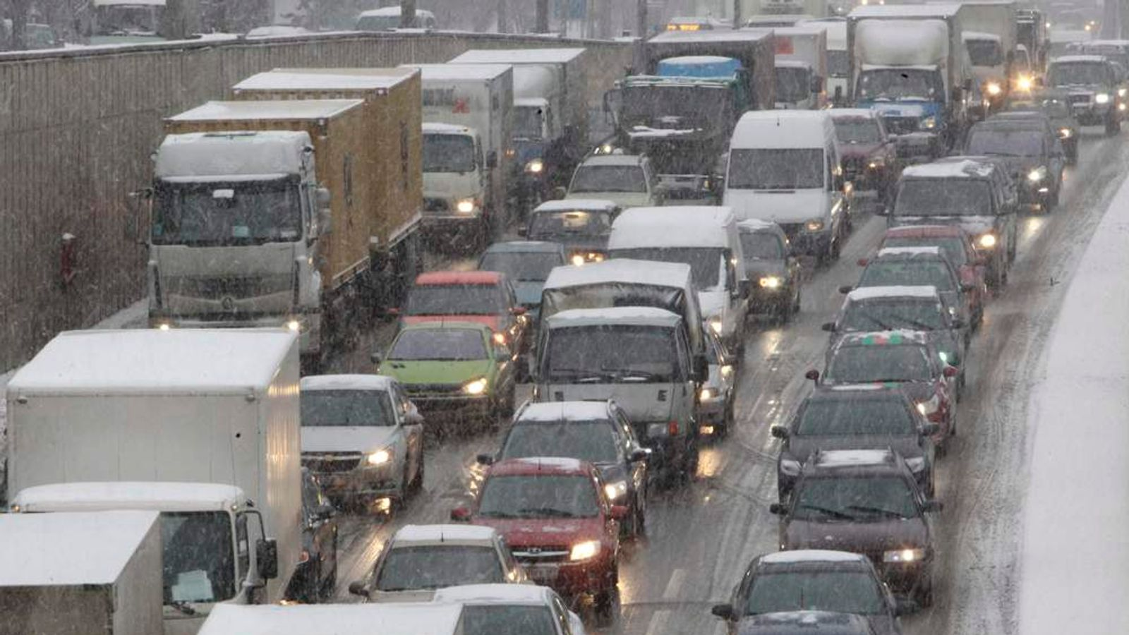 Cars and lorries in a traffic jam during a snowfall in Moscow, Russia