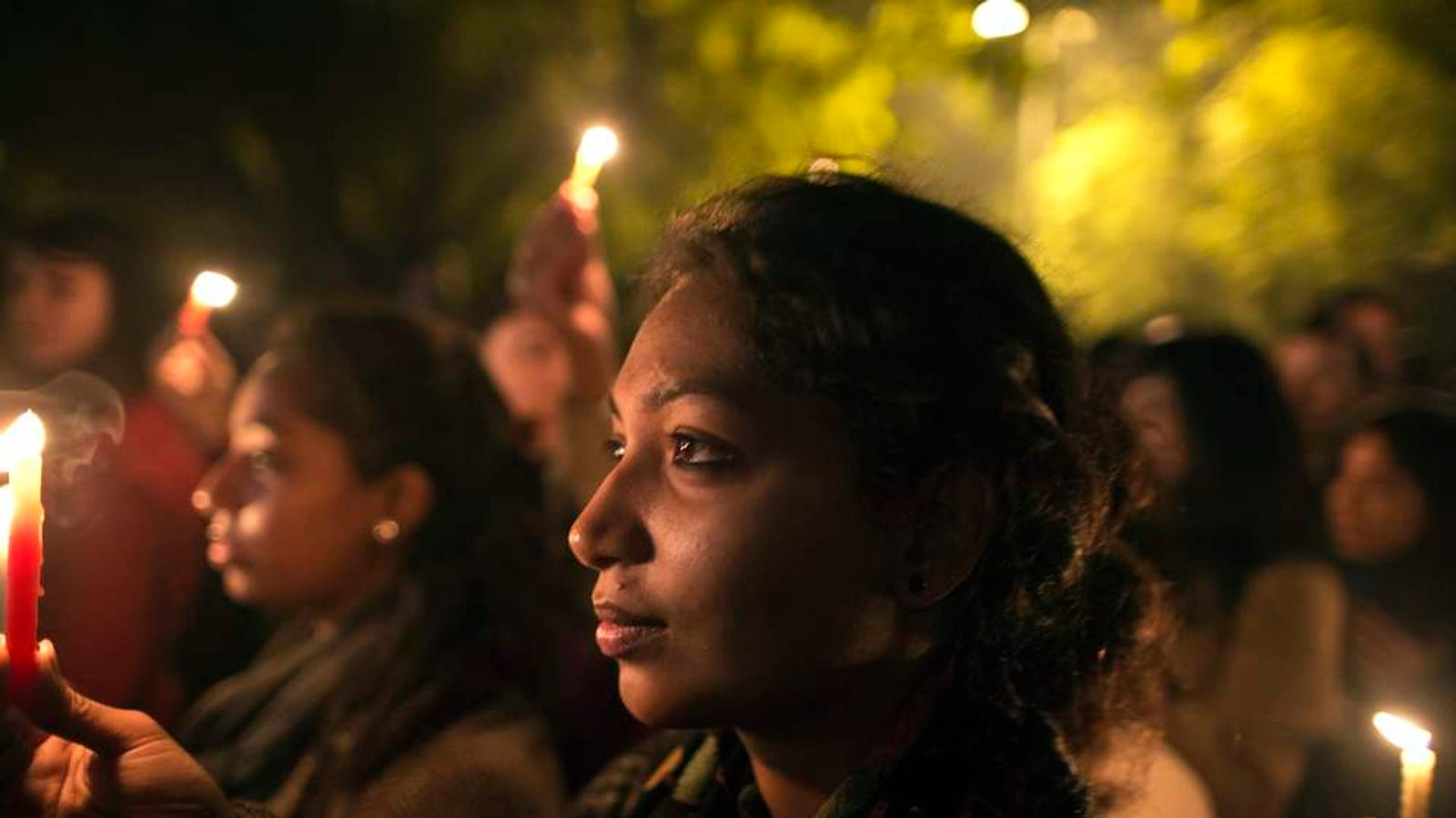 Demonstrators attend a candlelight vigil for a gang rape victim who was assaulted in New Delhi