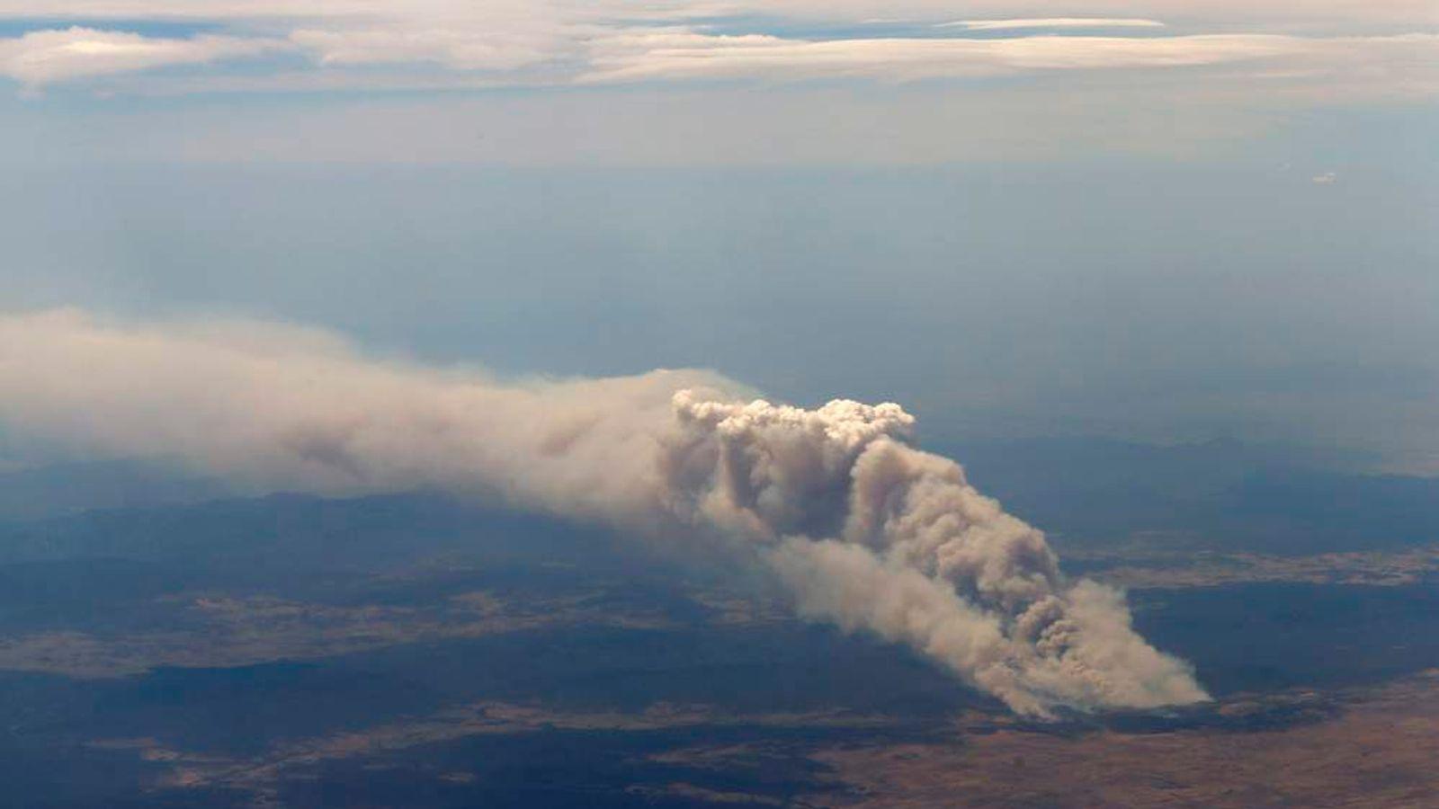 Smoke rises from the Yarrabin bushfire