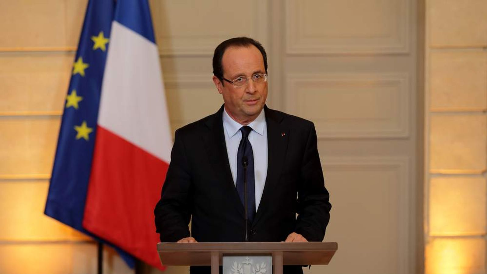 ce's President Hollande arrives to deliver a statment on the situation in Mali at the Elysee Palace in Paris