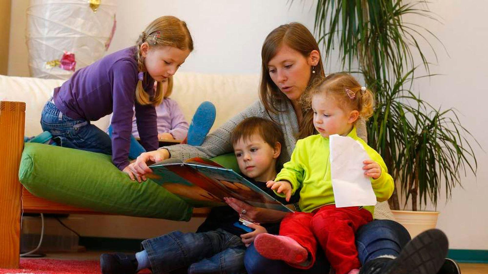 Children listen to their nursery school teacher
