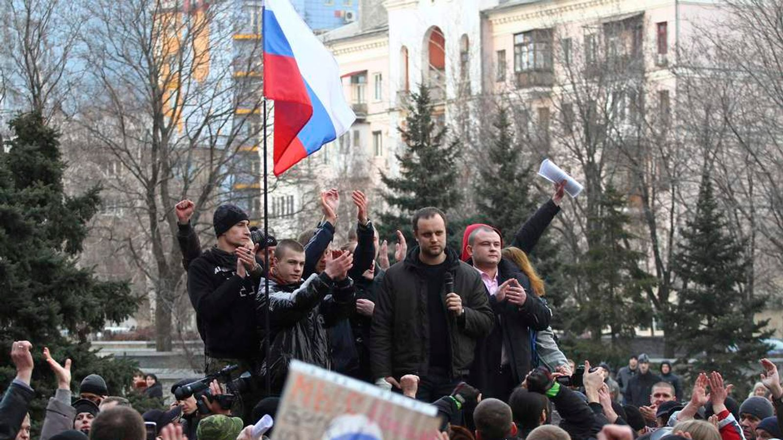 Protest leader Gubarev and other pro-Russian demonstrators take part in a rally in front of regional government building in Donetsk