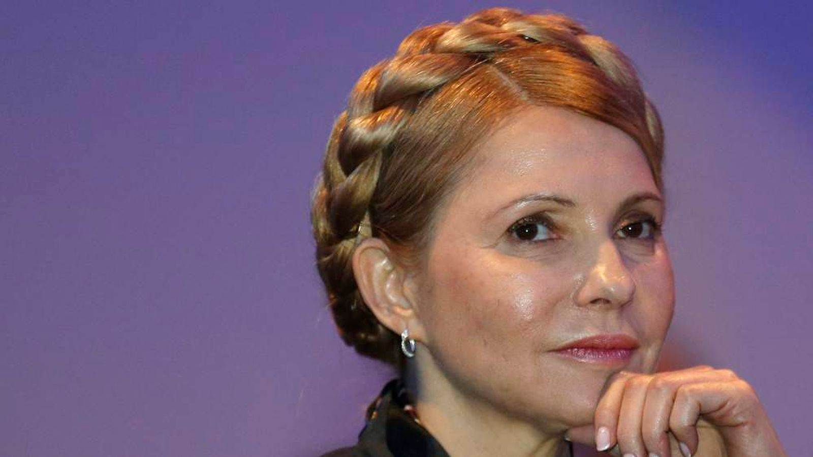 Yulia Tymoshenko listens to a speaker in Dublin