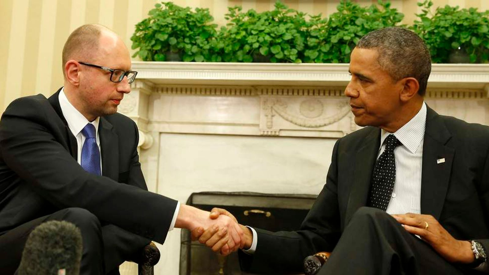 U.S. President Barack Obama shakes hands as he hosts a meeting with Ukraine Prime Minister Arseniy Yatsenyuk in the Oval Office of the White House in Washington