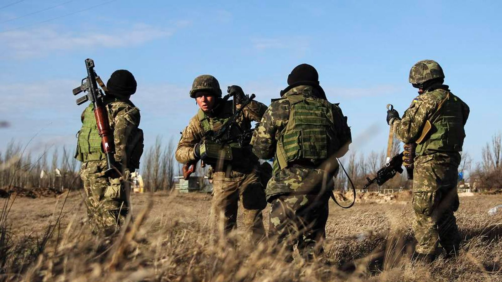 Ukrainian servicemen guard a checkpoint near the village of Strelkovo in Kherson region adjacent to Crimea