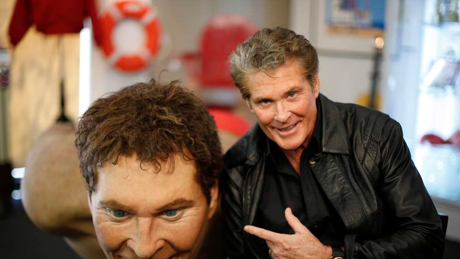 David Hasselhoff poses for portrait in front of belongings he is auctioning in Beverly Hills