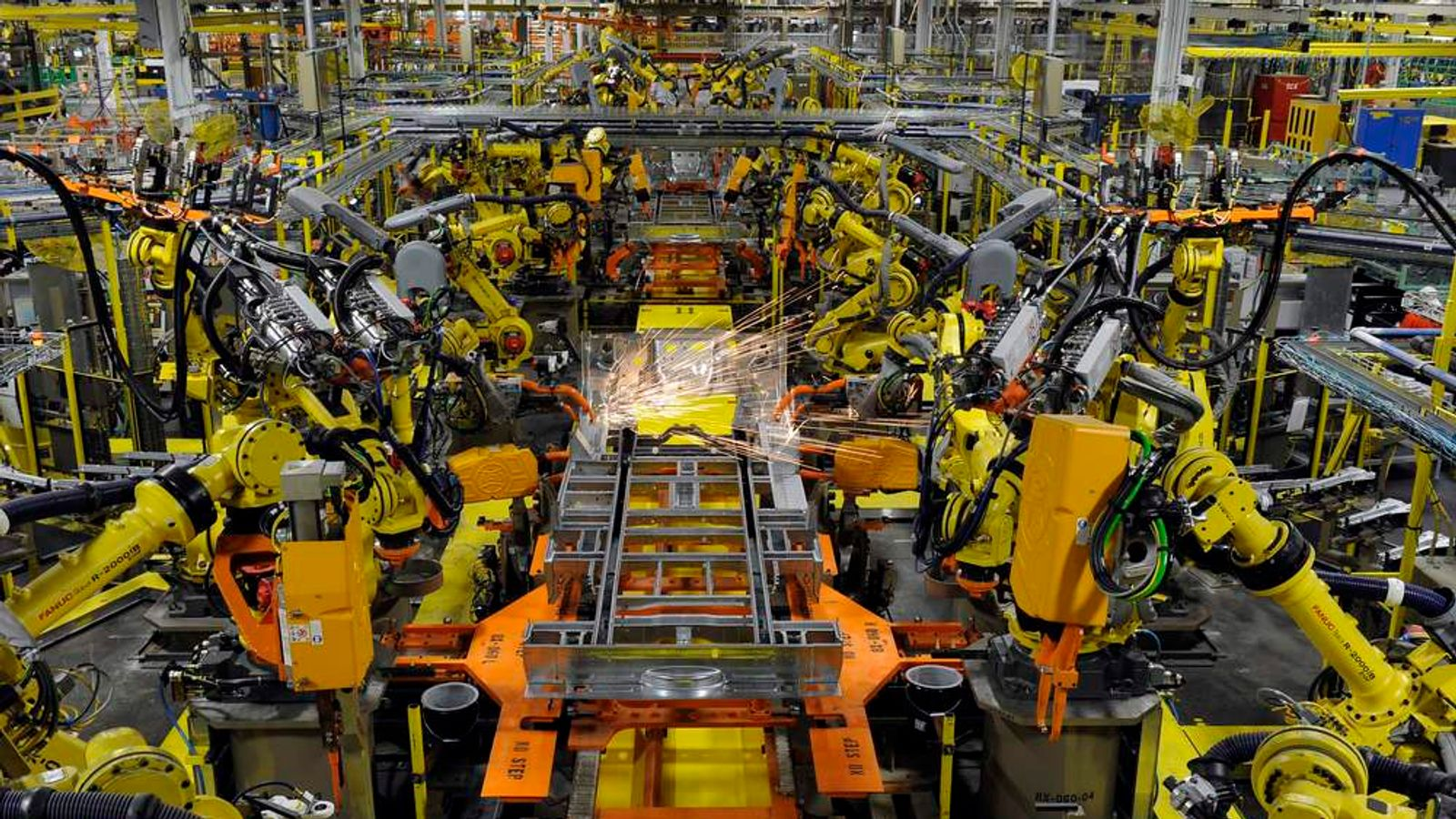 Robotic arms spot welds on the chassis of a Ford Transit Van under assembly at the Ford Claycomo Assembly Plant in Claycomo, Missouri.
