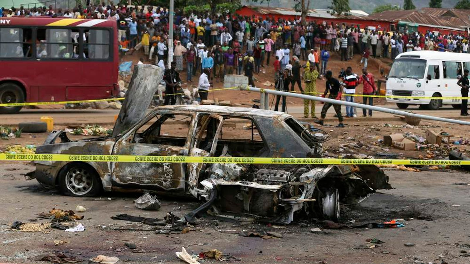 A damaged car is seen at the scene of a car bomb blast in Nyanya, Abuja