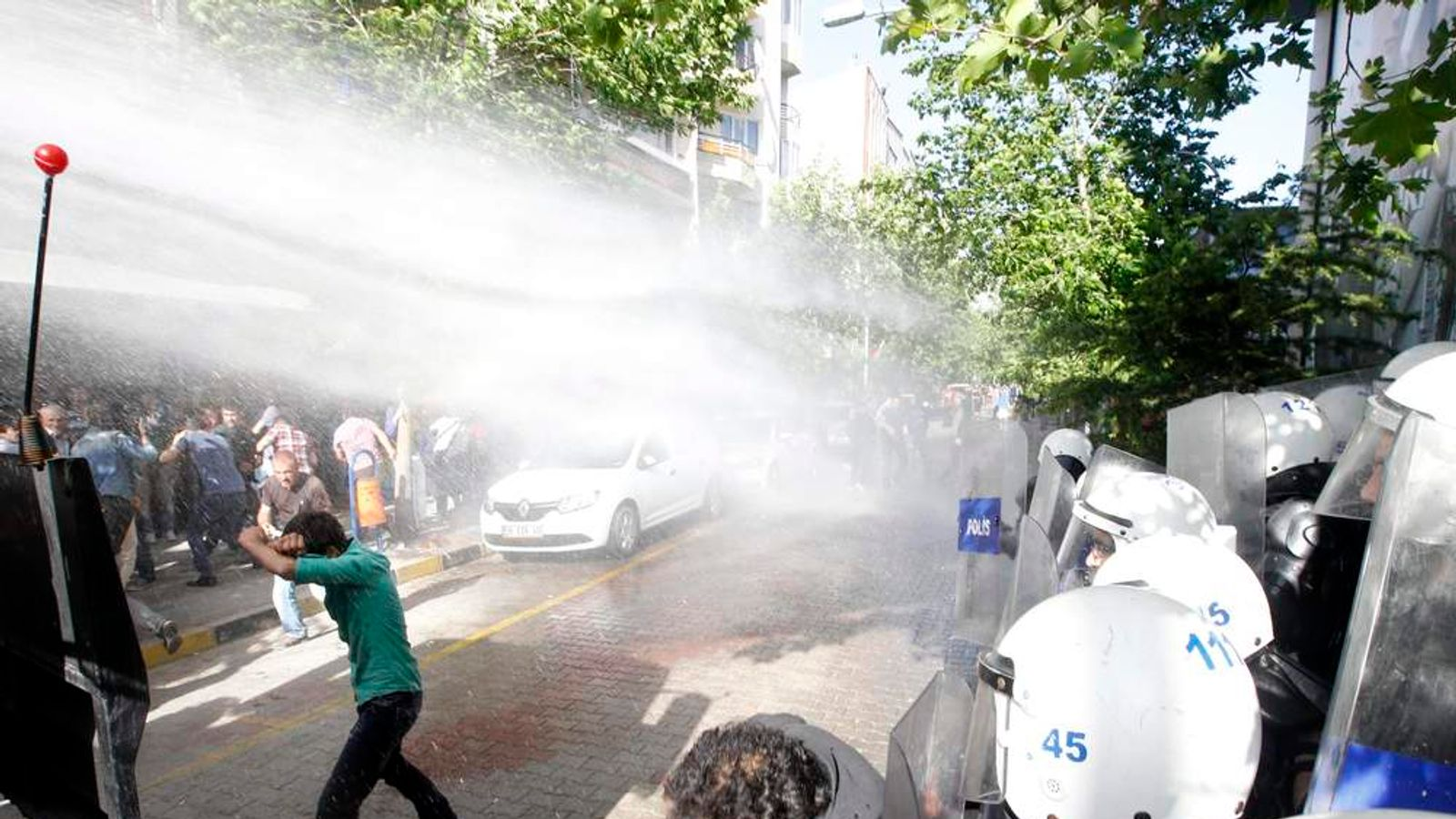 Police use water cannons against protesters as they demonstrate to blame the ruling AK Party government for the mining disaster in Soma