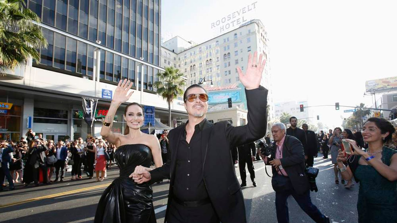 Brad Pitt is attacked on the red carpet at the premiere of Maleficent.
